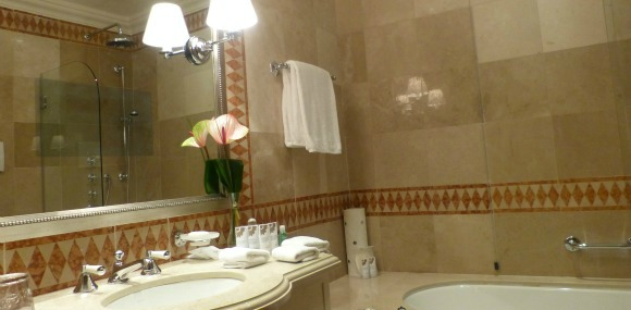 St Regis Florence Bathroom - The dark rectangle in the mirror is a built in television