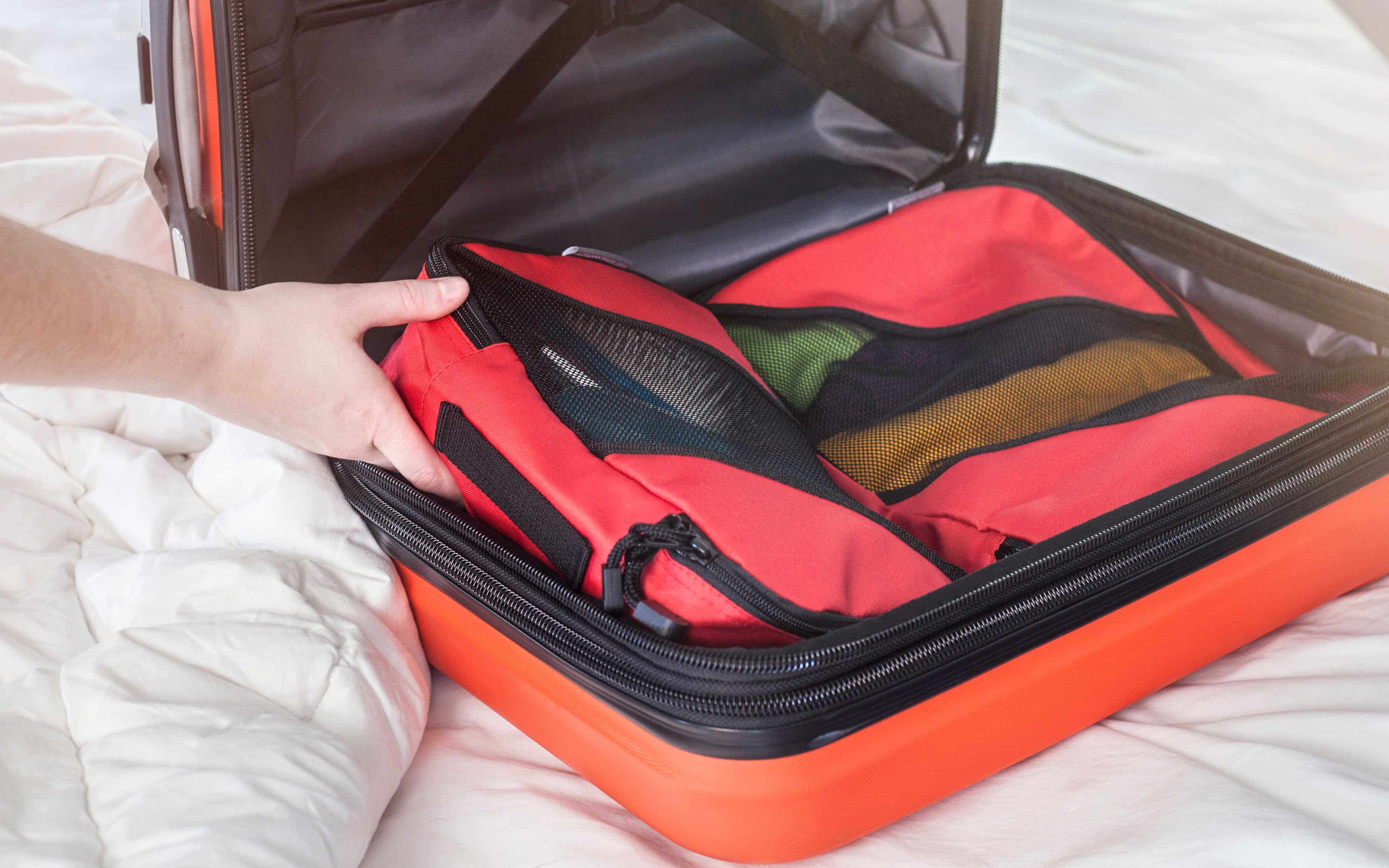 how to pack one bag for travel with packing cubes