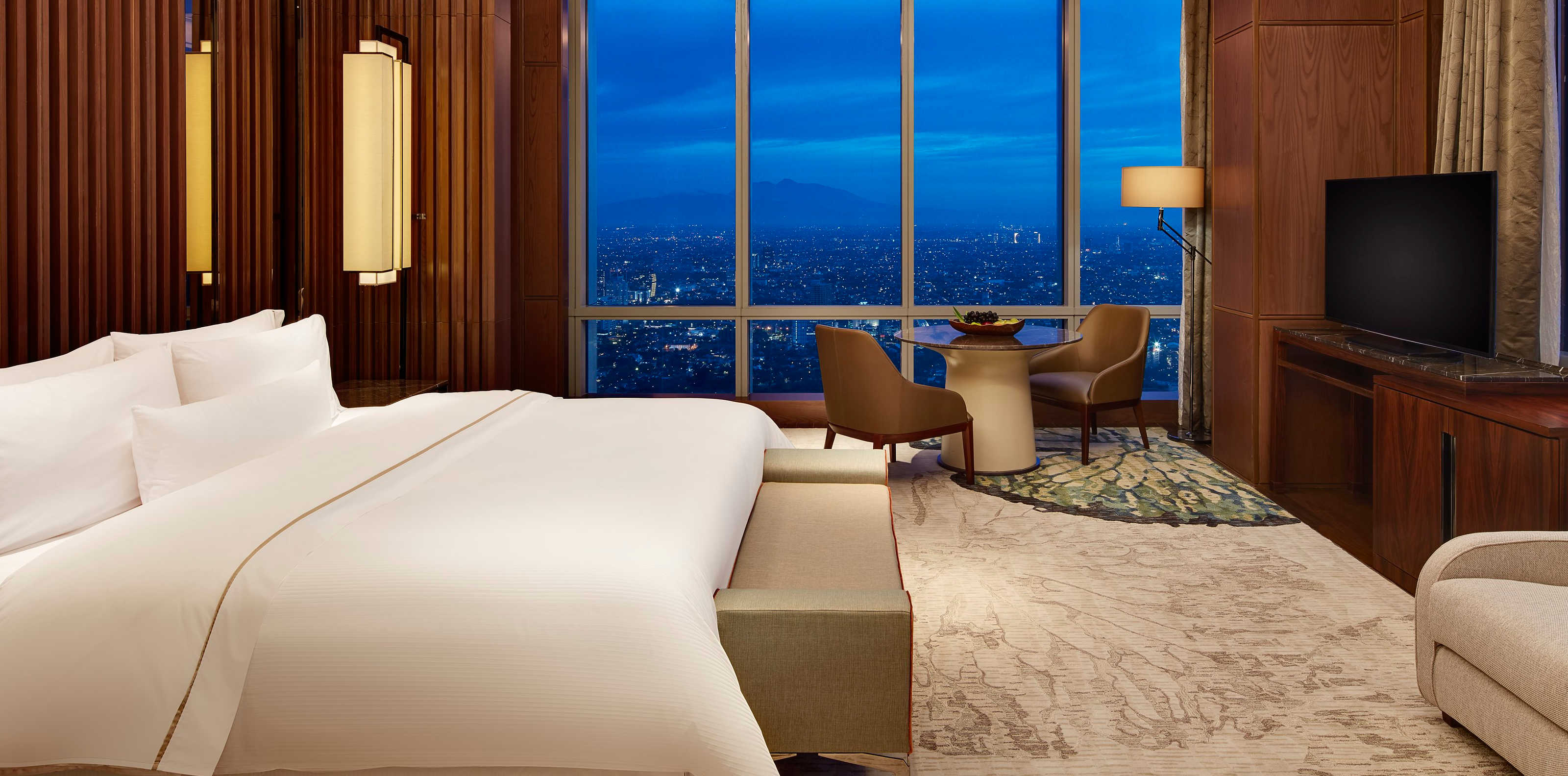 Bonvoy Titanium members can get complimentary upgrades to suites like this one at the Westin Jakarta
