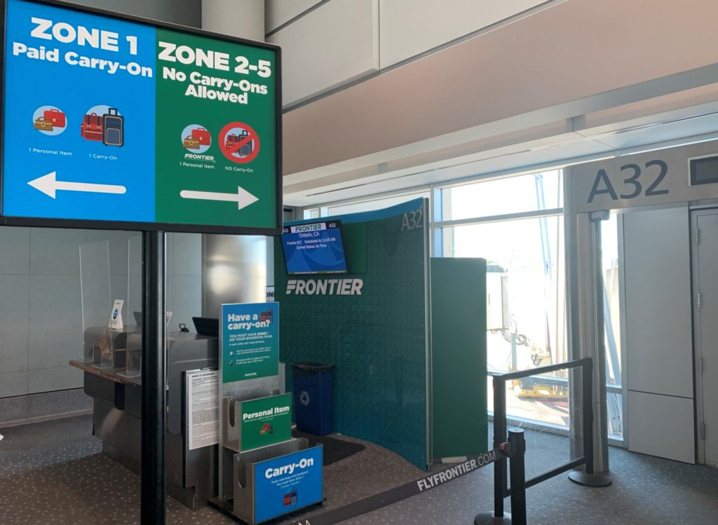 Frontier Airlines Personal item size checker and boarding sign